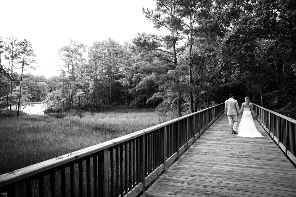 Bride and Groom walking at the virginia aquarium in Virginia Beach Virginia