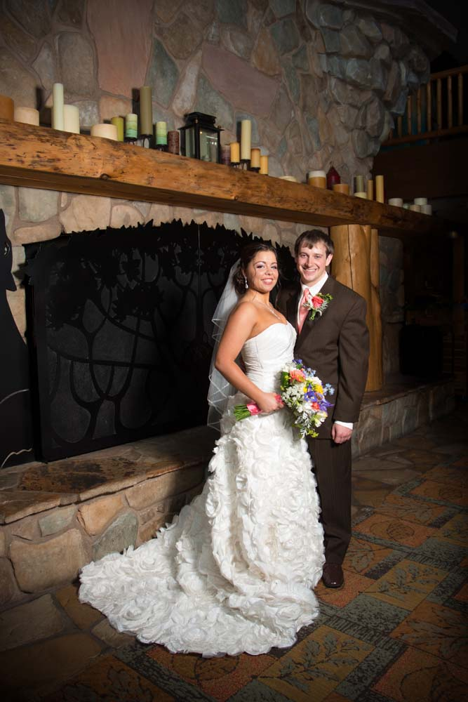 Posing in front of the fireplace at Great Wolf Lodge