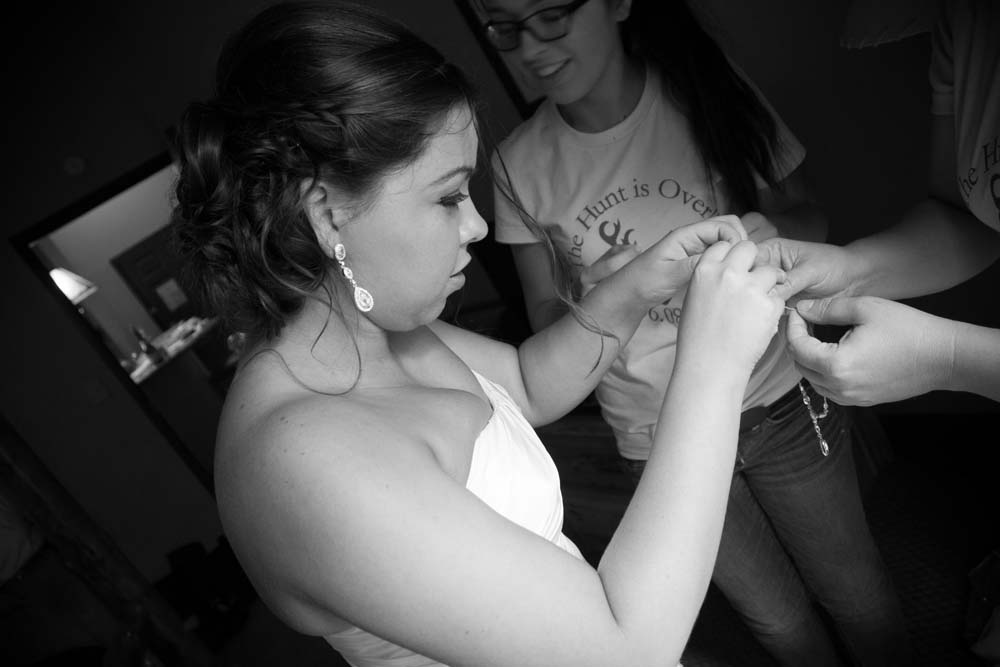Bride making final adjustments before her Great Wolf Lodge wedding