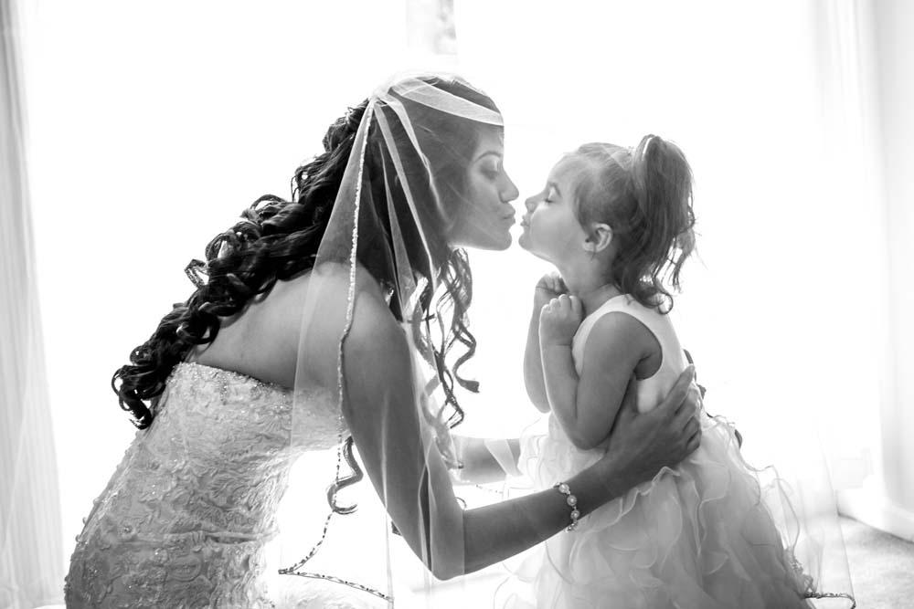 Virginia Beach Bride before the wedding sharing a moment