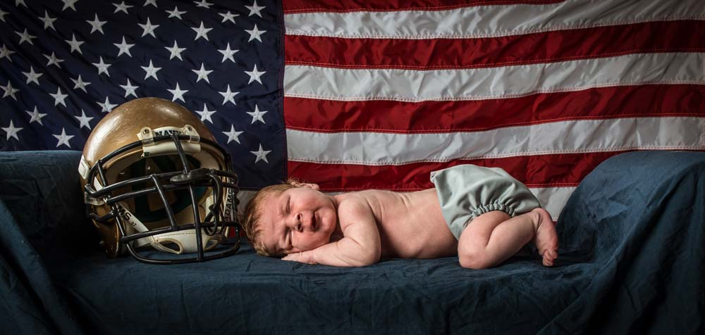 Military images of a newborn with the flag