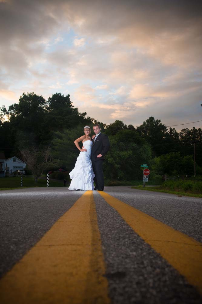 Bride and groom in the road posing at a Roanoke Virginia wedding hokies wedding