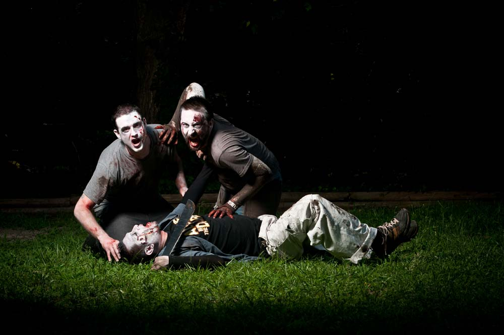 engagement session with zombie attack in Virginia Beach Virginia Themed session