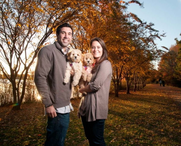 Chesapeake Park photographer with a couple during a photo shoot with their Dogs