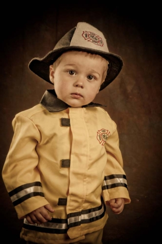 Toddler in a fireman outfit in studio in Virginia Beach Virginia
