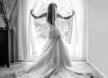 Wedding day bride in the window
