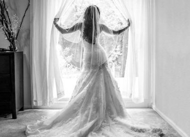 Wedding day bride in the window