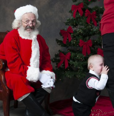 Virginia Beach Santa with crying child