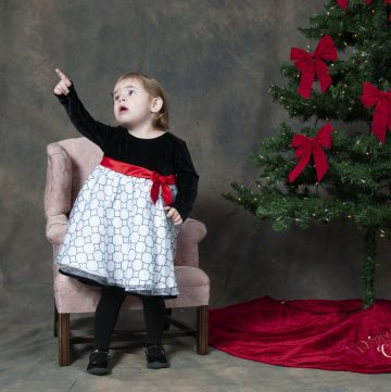 Picture of a young girl who was upset by santa. took pictures with dad for composite image.