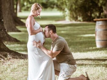 Virginia Beach Maternity Photographer with Mother and Father to be on a farm for a Maternity session.