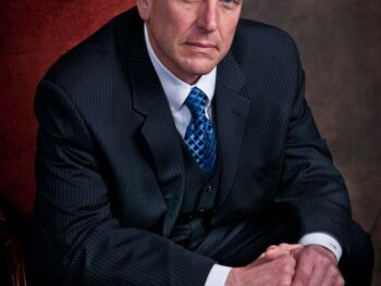 Attorney in his office for a headshot on location
